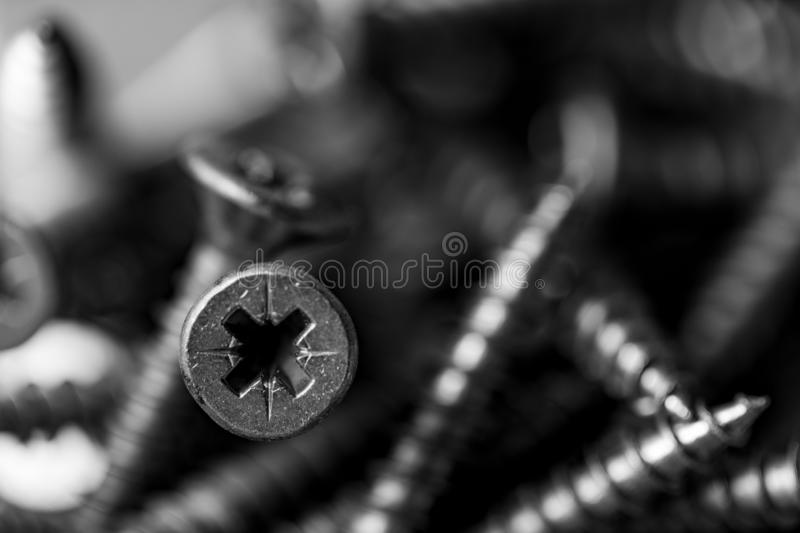 Macro photo of screws. Set of screws. Construction abstraction. Industrial background stock images