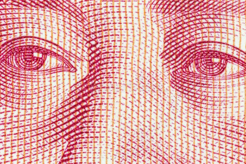 Macro Photograph of Eye Detail on Chinese Yuan Currency. Macro close up photograph of Mao eyes detail on the Chinese Yuan currency note royalty free stock photo