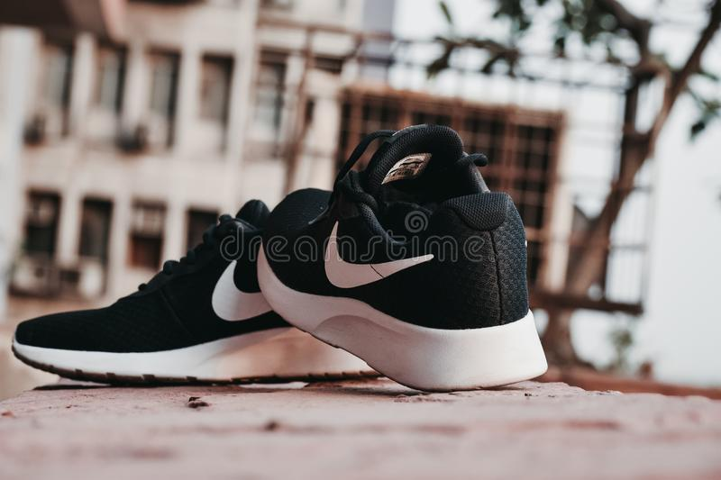 Macro Photography of Pair of Black-and-white Nike Running Shoes stock photography