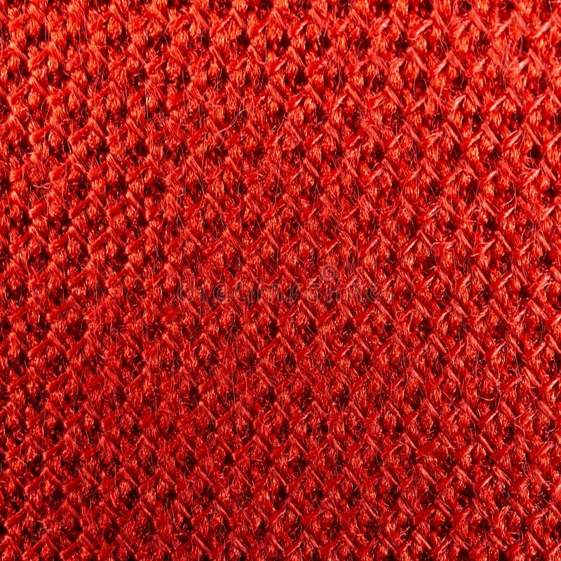 Macro picture of red fabric texture mesh pattern royalty free stock photos