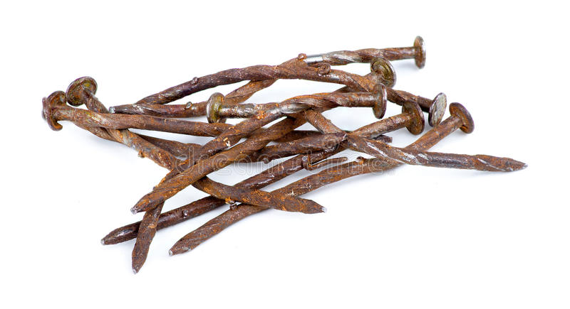 Macro of pile of rusty nails isolated against white stock image