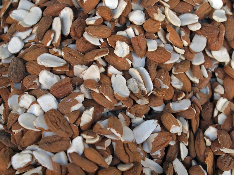 Delicious sweet almonds, tasty and healthy food. Macro of a pile of sweet almonds at a food market stock images