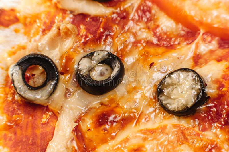 Macro pizza with tomatoes, cheese and olives stock images