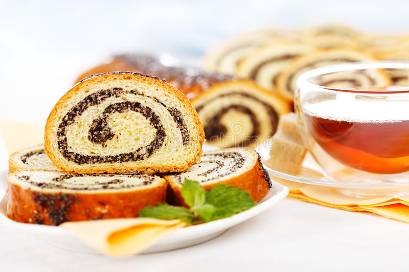 Download Macro Of Poppy Seed Roll Slices And Tea Stock Image - Image: 26375911