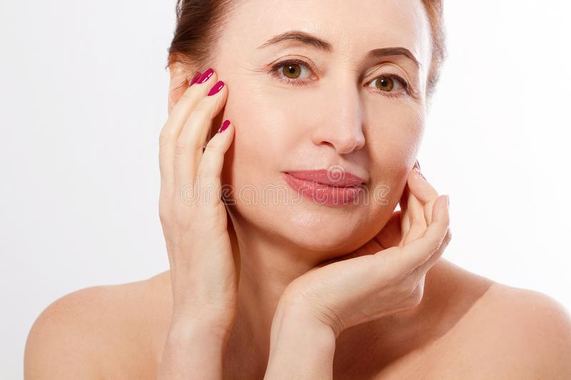 Macro Portrait Elderly Woman Face Isolated. Spa and Skin Care. Collagen and Plastic Surgery. Anti aging and Body Care Concept. Copy Space and Mock Up royalty free stock photo