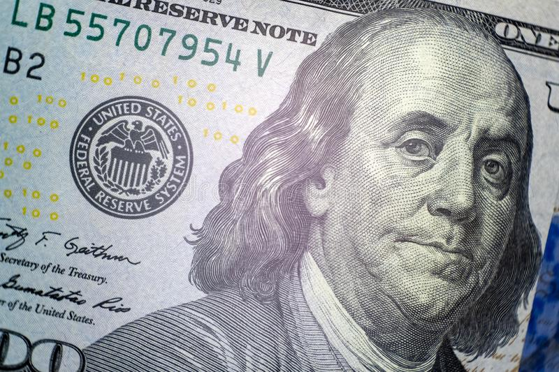 Portrait of Franklin. Close-up of a part of the US hundred dollar bill. Macro. Symbol of wealth and financial success stock photo
