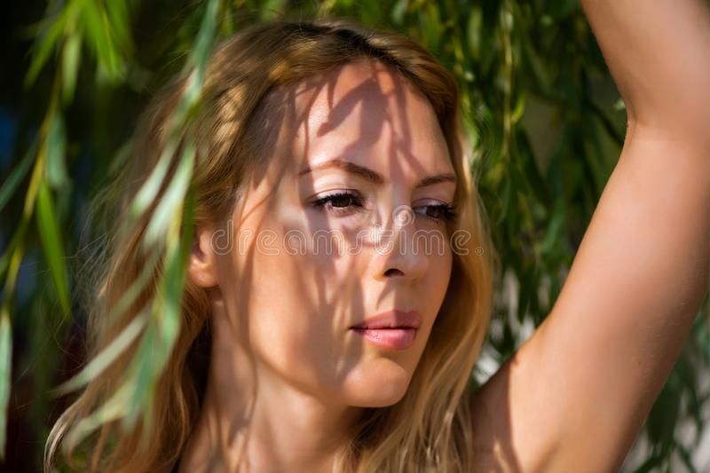 Macro portrait of young beautiful blond woman stock images