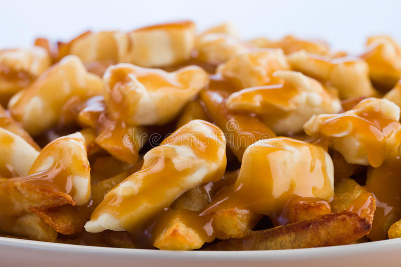 Macro poutine. Poutine meal made with french fries, cheese curds and gravy. Macro photography with shallow depth of field royalty free stock photography
