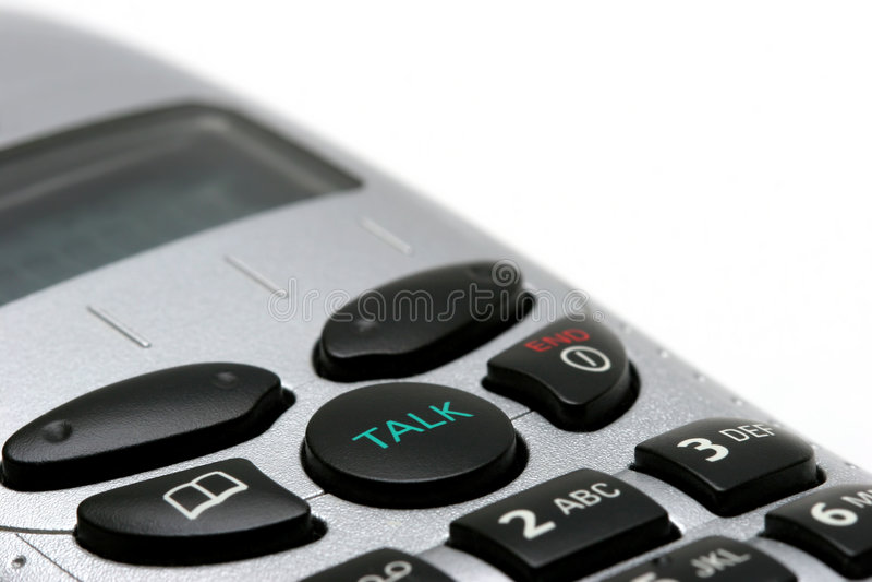 Macro sem fio do telefone no branco fotografia de stock