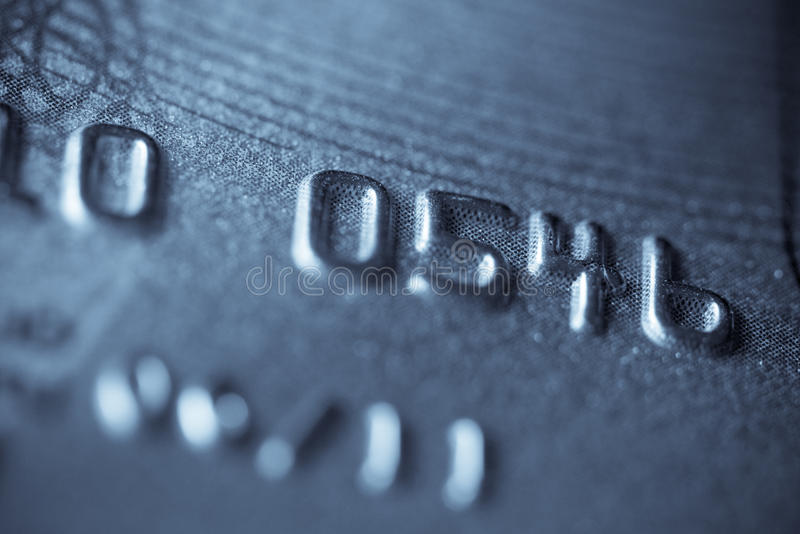 Macro shoot of a credit card. Digits in focus. Can be used as a background stock photos