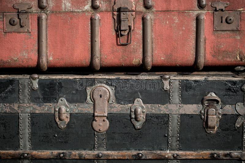 Old vintage antique suitcases trunks in a stack background. Macro shoot of old vintage antique suitcases trunks in a stack background royalty free stock images