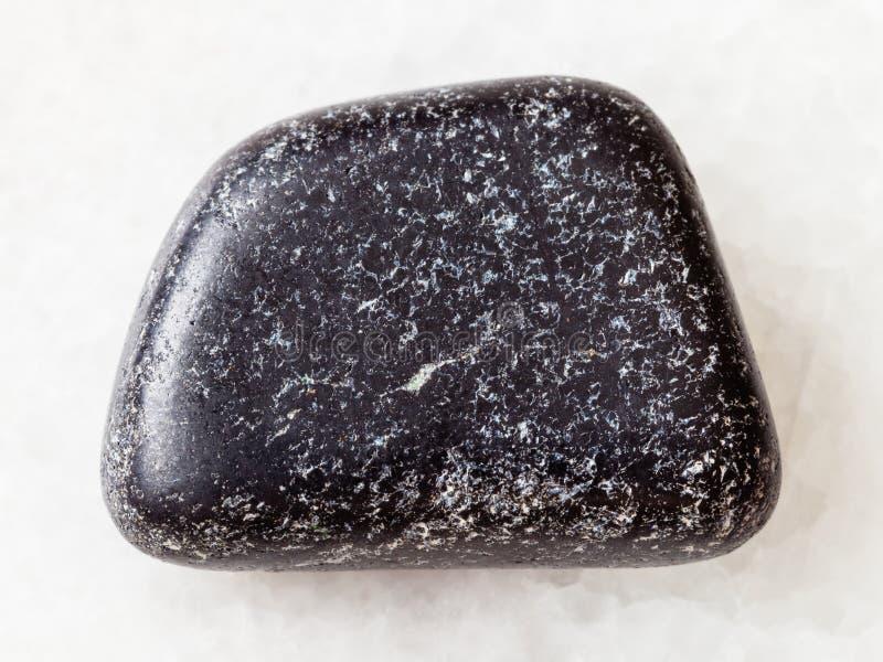 tumbled Chromite stone on white royalty free stock images