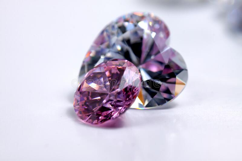 Macro shoots of pink color round shaped shiny diamond isolated royalty free stock image