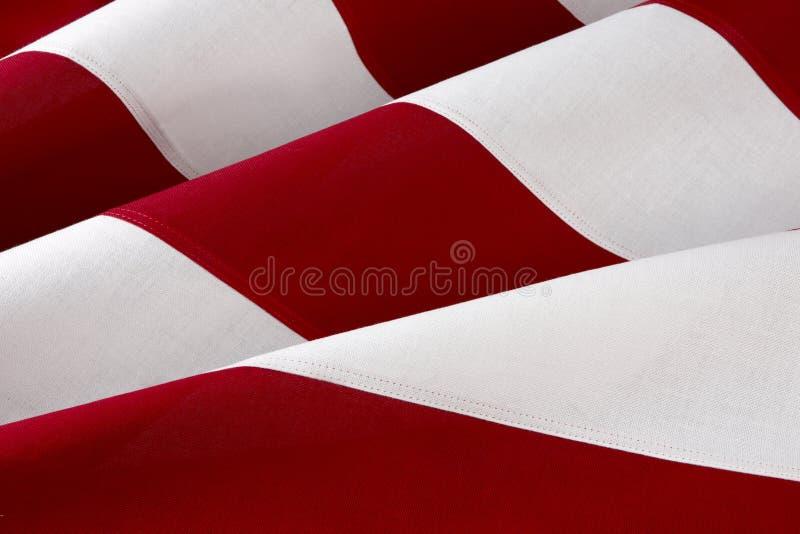 Macro shot of American flag. Extreme close up shot of red and white stipes of the American flag royalty free stock photo