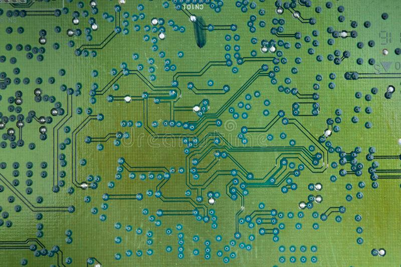 Macro shot of back side circuit board. Top view with copy space. royalty free stock photography