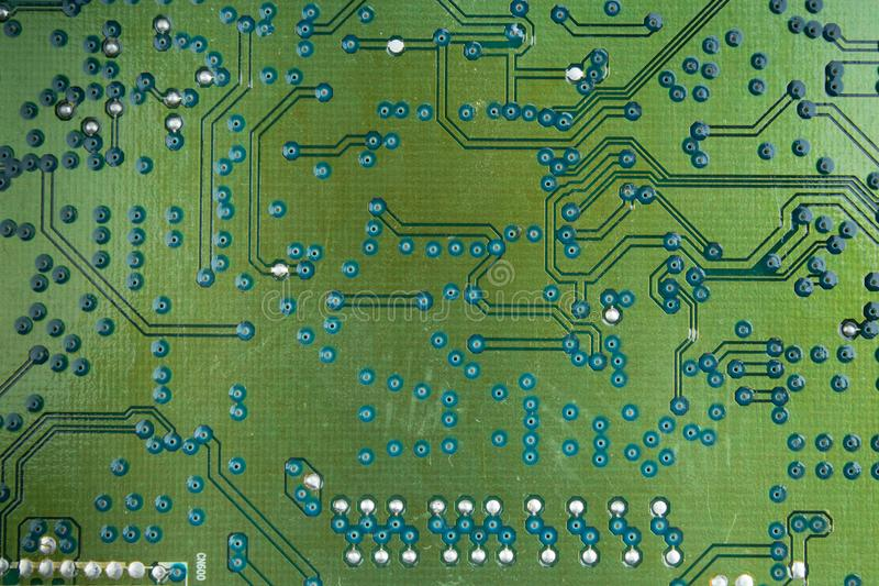 Macro shot of back side circuit board. Top view with copy space. royalty free stock photos