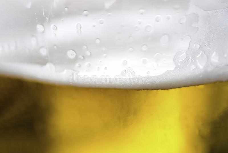 Macro shot of beer in glass royalty free stock photos