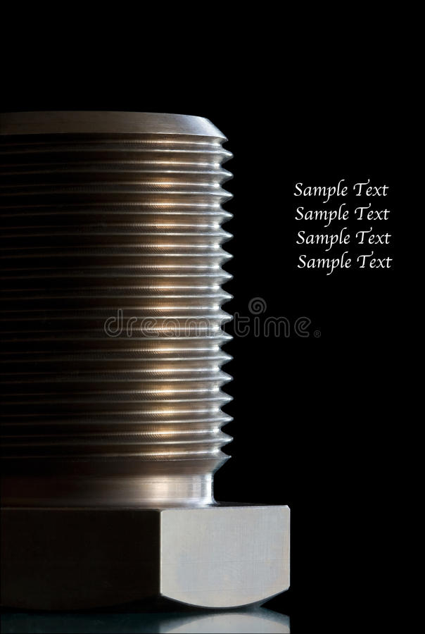 Macro shot of a bolt. Against black background with side light stock photography