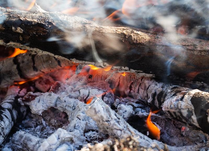 Macro shot of Burning coal. Glowing embers smoldering in the fireplace royalty free stock photos