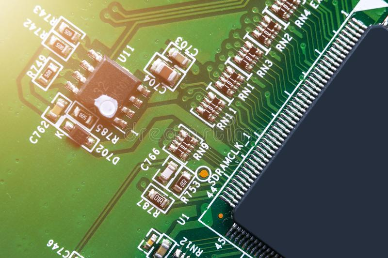Macro shot of a Circuitboard with resistors microchips and electronic components. Computer hardware technology. Integrated communi. Cation processor. Information stock photo