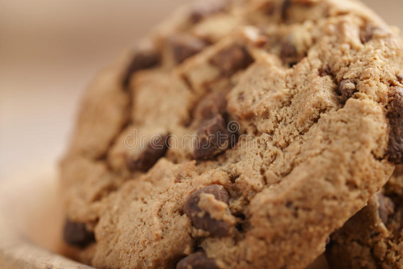 Macro shot of classic chocolate chip cookies in bowl stock images