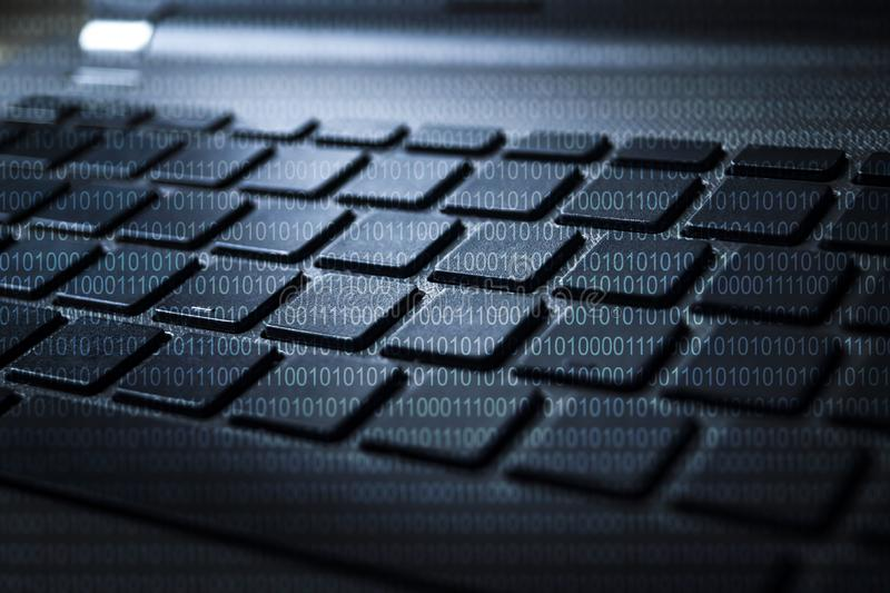 KEYBOARD OF LAPTOP WITH BINARY DIGITS royalty free illustration