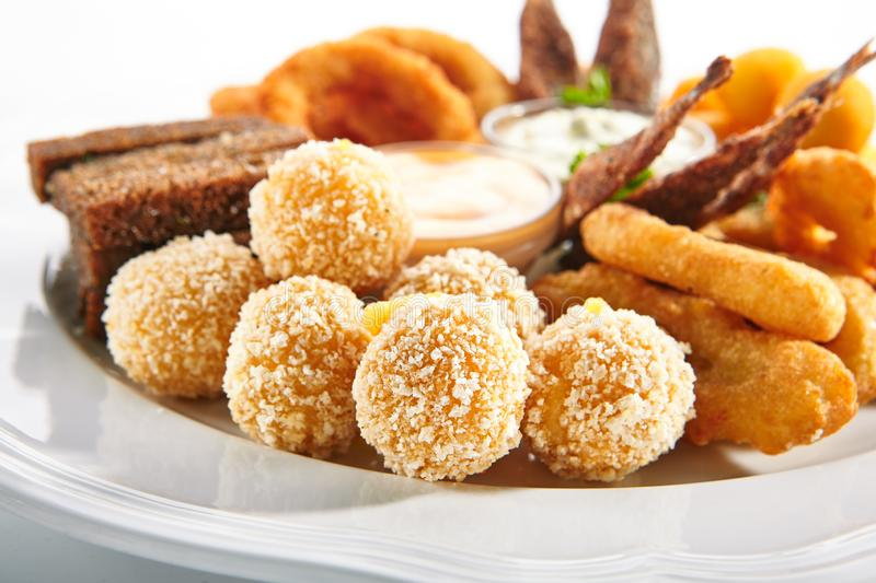 Deep-Fried Snack Plate with Crisp Potato Croquettes and Cheese Balls stock images