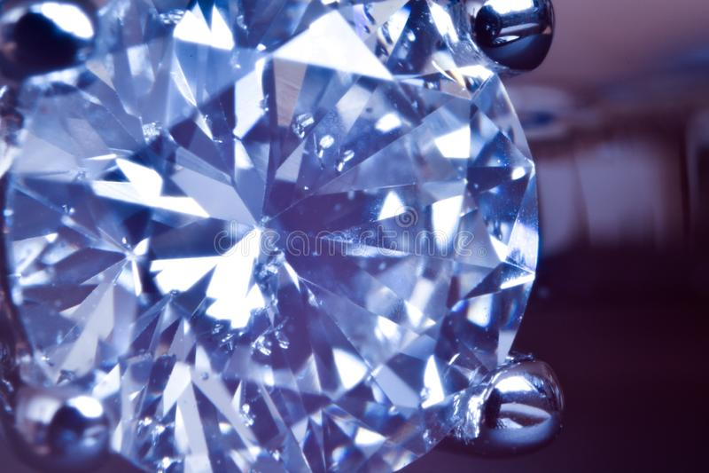 Macro shot of diamond engagement ring. Visible diamond impurities stock images