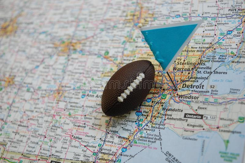 Detroit. Macro shot of a flag and football placed on Detroit, Michigan in a map royalty free stock image