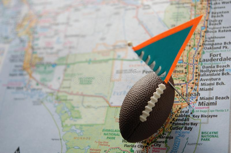Miami. Macro shot of a flag and football placed on Miami, Florida in a map stock photos
