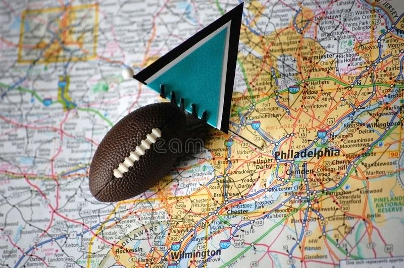 Philadelphia. Macro shot of a flag and football placed on Philadelphia, Pennsylvania in a map royalty free stock photos