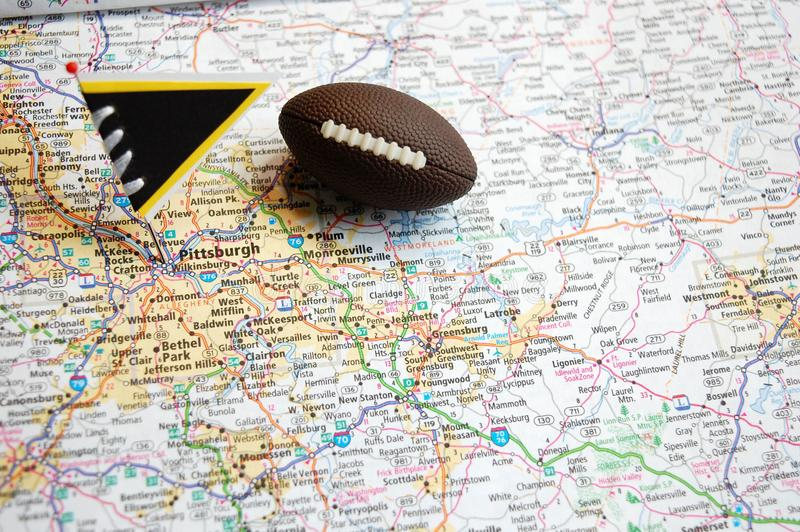 Pittsburgh. Macro shot of a flag and football placed on Pittsburgh, Pennsylvania in a map royalty free stock photography