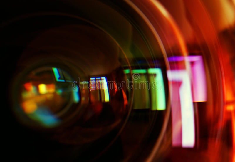 Macro shot of front element of a camera lens. With beautiful color lights reflections royalty free stock images