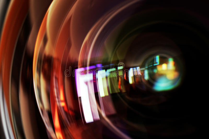 Macro shot of front element of a camera lens. With beautiful color lights reflections royalty free stock photos
