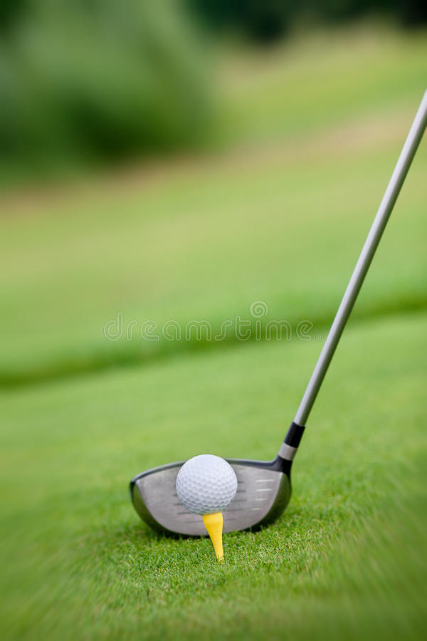 Macro shot of a golf club ready to drive the ball royalty free stock photography