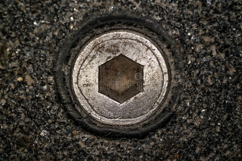 Macro shot of hex head bolt screw thread. Close up view of rustic hexagon screw head stock photo