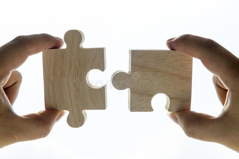 Macro shot of jigsaw puzzles teamwork concept stock images