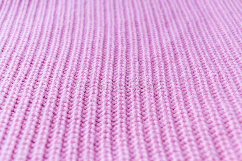 Macro shot of knitted fabric from Lana Wool threads. Texture of pink cashmere sweater background. Surface, closeup, organic, white, pattern, soft, material stock image