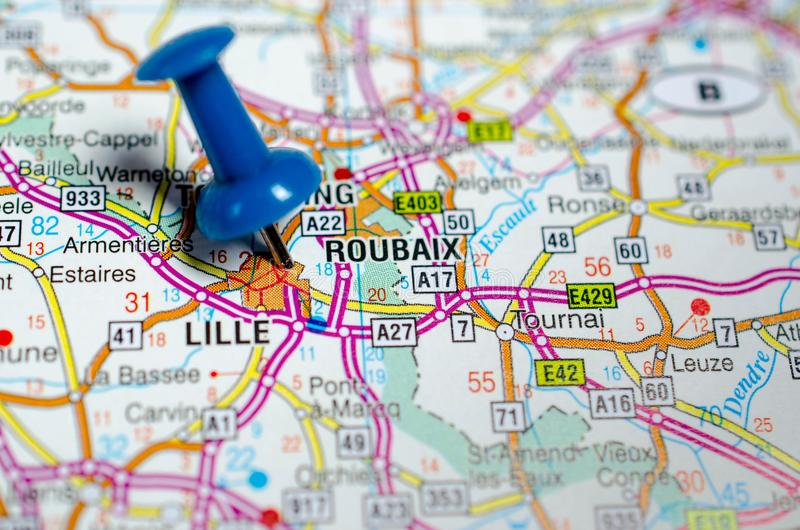 Lille on map. Macro shot of Lille and Roubaix on map with push pin royalty free stock image