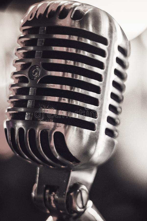 Macro shot of an old vintage silver microphone. Studio royalty free stock image