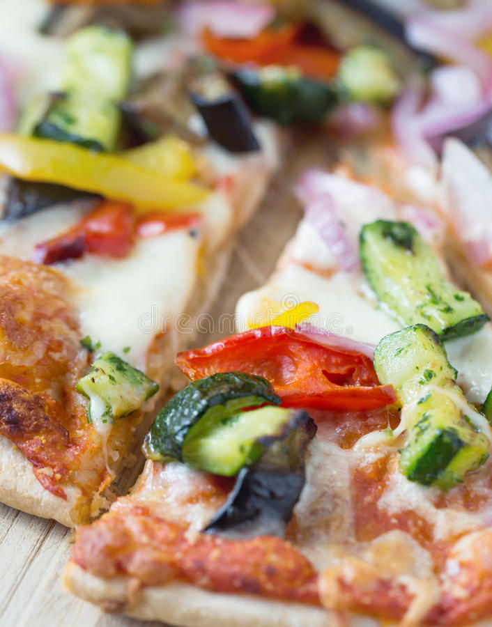 macro shot of pizza with vegetables royalty free stock photo