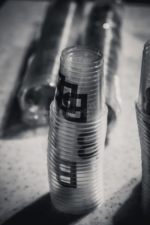 Macro shot of plastic cups for degustation stacked on a table. Switzerland royalty free stock photo