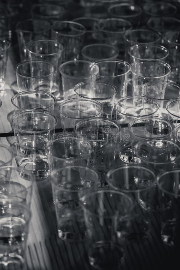 Macro shot of plastic cups for degustation standing on a table. Switzerland royalty free stock photo