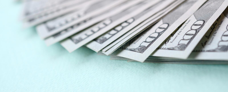 Macro shot with shallow depth of field. Hundred US dollar bills royalty free stock photo