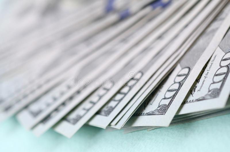 Macro shot with shallow depth of field. Hundred US dollar bills stock photo