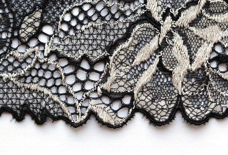 The macro shot of the white and black lace texture material stock photos