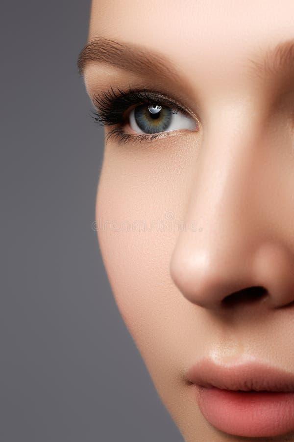 Macro shot of woman`s beautiful eye with extremely long eyelashe stock photography