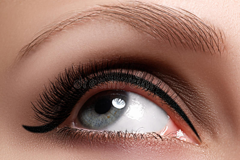 Macro shot of woman`s beautiful eye with extremely long eyelashes. View, sensual look. Female eye with long eyelashes stock image
