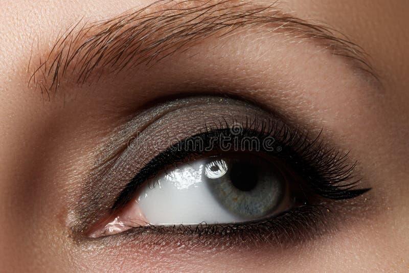 Macro shot of woman`s beautiful eye with extremely long eyelashes. View, sensual look. Female eye with long eyelashes royalty free stock image