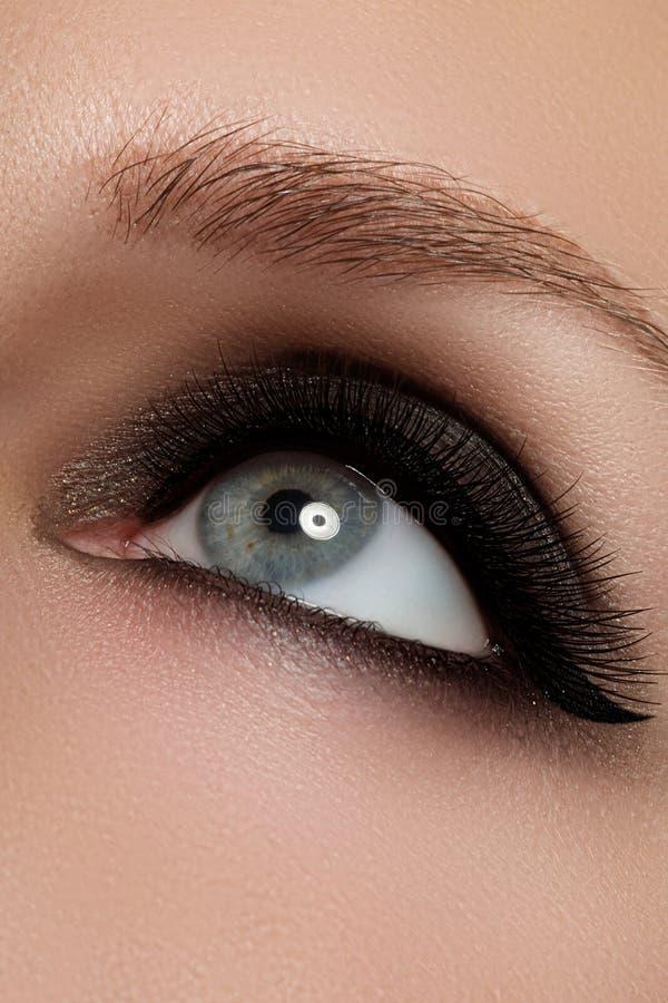 Macro shot of woman`s beautiful eye with extremely long eyelashes. View, sensual look. Female eye with long eyelashes stock images
